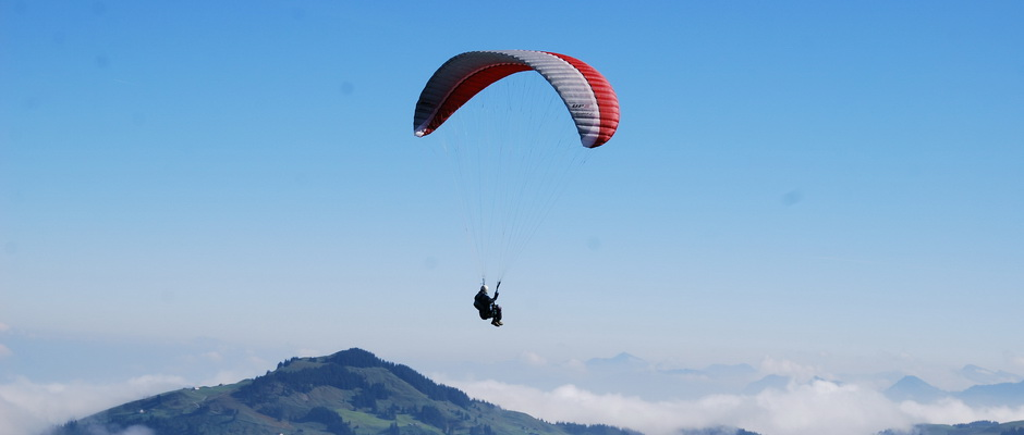 paragliding over the clouds